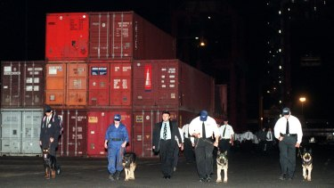 1998: Security guards assembling themselves at Port Botany Patrick Terminal around midnight on April 7.