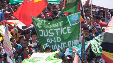 At least 10,000 people gathered outside the Australian embassy in Dili, the capital of East Timor, on Tuesday to protest against Australia's stance on the oil and gas meridian line in the Timor Sea.