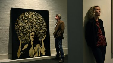Artist James Powdtich with his entry in the Archibald portrait prize of Cath Keenan (pictured) which is now in the Salon des Refuses.