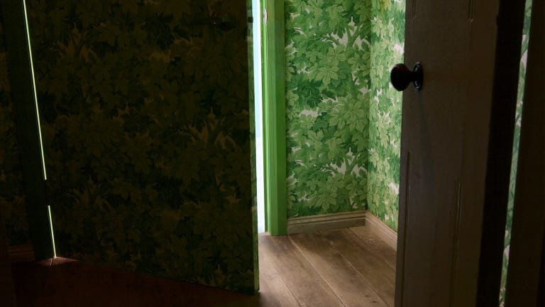 A burst of greenery changes the mood in 1000 Doors.