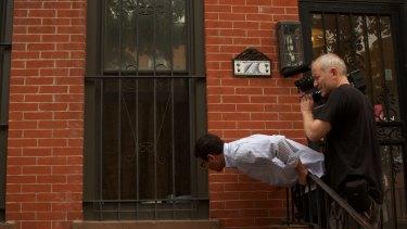 In a scene from <i>Breaking the Silence</i>, a cameraman follows Manny Waks.