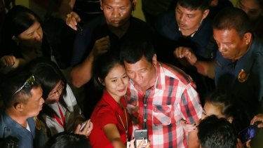Even before the polls closed Mr Duterte, here in a selfie with a supporter, called for an end to acrimony.