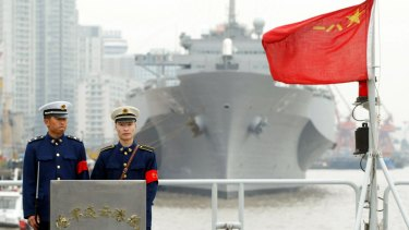 Two Chinese soldiers stand guard on the warship Lianyungang in 2004.