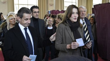 Former French president and current opposition leader Nicolas Sarkozy and former first lady Carla Bruni-Sarkozy in Paris last Sunday.
