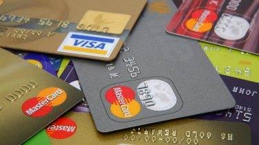 Small banks warn debit-card fee cuts hit them hardest