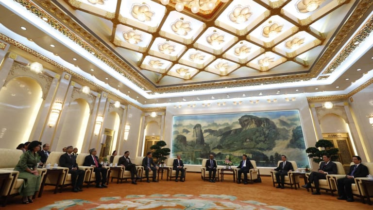 China's President Xi Jinping (fourth right) meets guests at the Asian Infrastructure Investment Bank (AIIB) launch ceremony in the Great Hall of the People in Beijing in October last year.