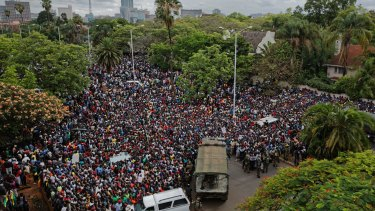 A crowd of thousands of protesters demand Robert Mugabe stand down last week.