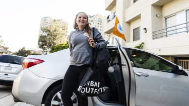 Emma Aluise, 12, arrives home after taking a HopSkipDrive ride from swim practice, in Los Angeles,