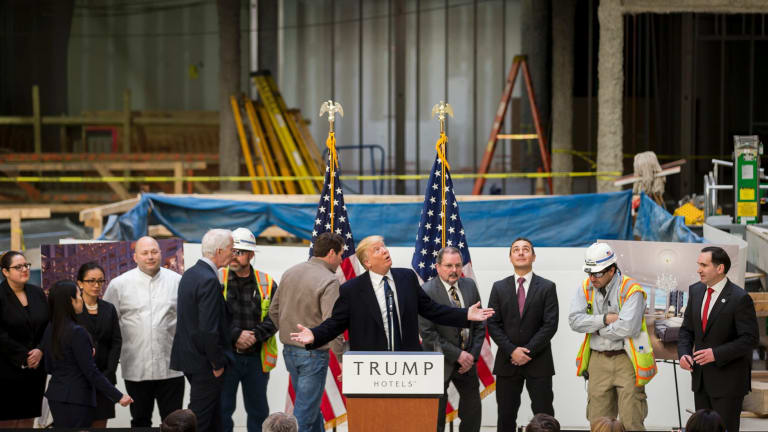 Donald Trump inside the under-construction Trump International Hotel in Washington in March 2016. In 2014, Deutsche Bank agreed to lend the Trump Organisation up to $US170 million to finance the gut renovation of the hotel.