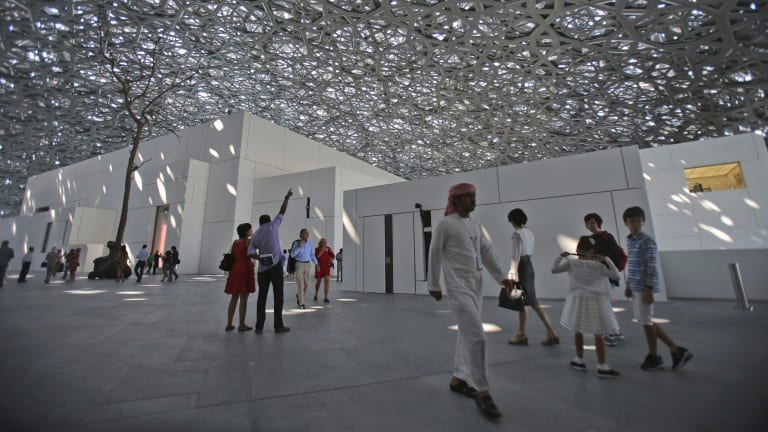 People visit the Louvre Museum during the public opening day, in Abu Dhabi, United Arab Emirates, in November.