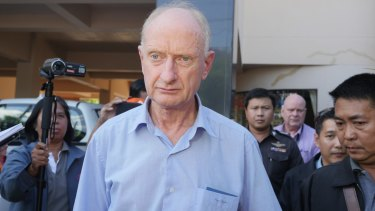 Peter Dundas Walbran with police after his arrest in Ubon Ratchathani, Thailand, on Wednesday.