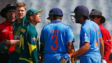 Having words: David Warner and India's Rohit Sharma (second from right) have an animated chat during the one-day series in January.