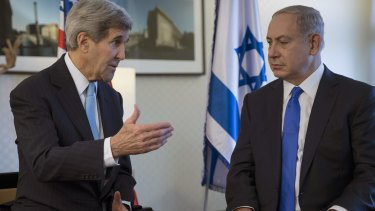 US Secretary of State John Kerry, left, speaks with Israeli Prime Minister Benjamin Netanyahu during a meeting in Berlin on Thursday.