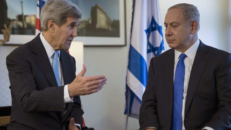 US Secretary of State John Kerry, left, speaks with Israeli Prime Minister Benjamin Netanyahu during a meeting in Berlin on Thursday.