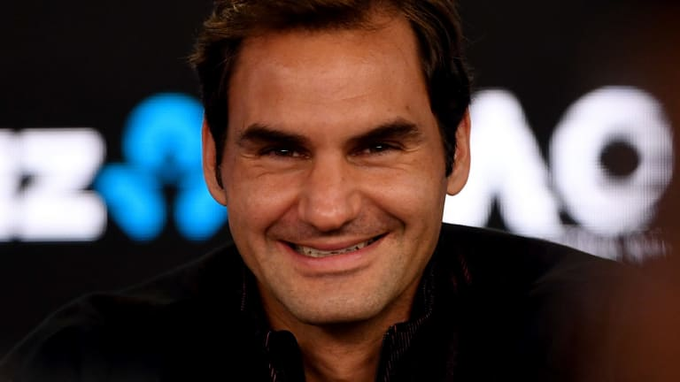 All smiles: Roger Federer addresses the media during press conference ahead of the 2018 Australian Open.
