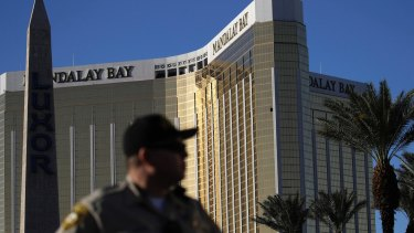 A Las Vegas police officer stands by a blocked off area near the Mandalay Bay casino in Las Vegas.