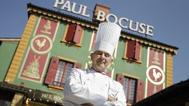 Bocuse outside his famed Michelin three-star restaurant L'Auberge du Pont de Collonges in Collonges-au-Mont-d'or in 2011.