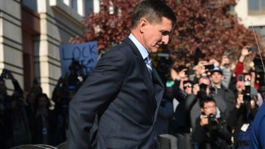 Michael Flynn leaves a federal court in Washington after pleading guilty.