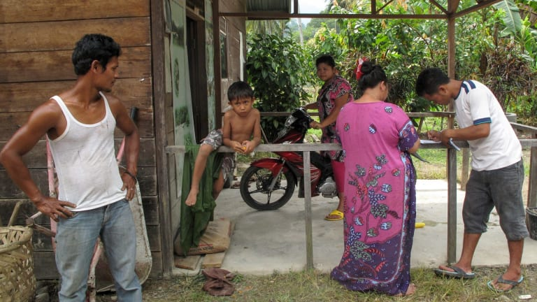 A family in the village of Ketambe, beside Gunung Leuser National Park, Sumatra.