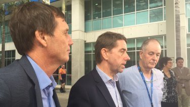 Queensland government ministers Anthony Lynham and Cameron Dick, with the head of Queensland's burns unit Michael Rudd.