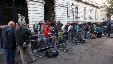 Media gather outside the home of British Prime Minister David Cameron at 10 Downing Street in London after the Brexit referendum.
