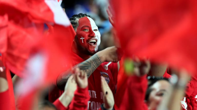 Shocking the world: Tongan fans celebrate in Hamilton.