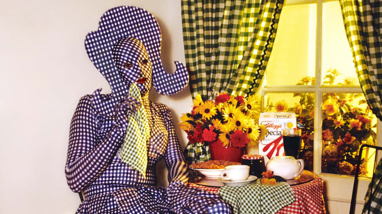 In creating Gingham Woman, the late Brenton Heath-Kerr covered himself in mauve and white fabric from head to toe, a nod to designer Jean-Paul Gaultier, at the 1991 Mardi Gras Sleaze Ball party.