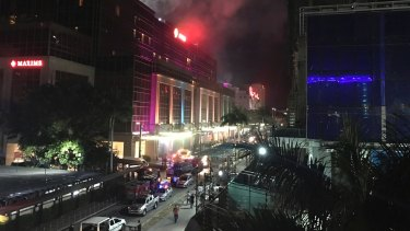 Gunshots and explosions rang out early Friday at a mall, casino and hotel complex near Manila's international airport in the Philippine capital, sparking a security alarm.