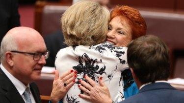In happier times: Senator Michaelia Cash hugged Senator Pauline Hanson after her first speech in the Senate on Wednesday.