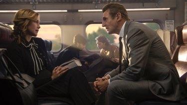 Vera Farmiga, left, issues Liam Neeson a challenge in <i>The Commuter</i>.