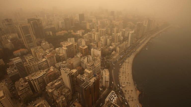An unseasonal sandstorm shrouds Beirut, Lebanon, on Tuesday.