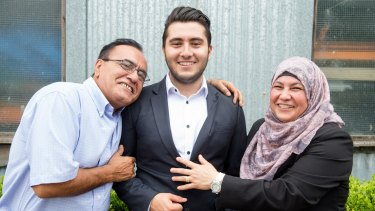 Hicham Jansis with his parents at the first-in-course ceremony.