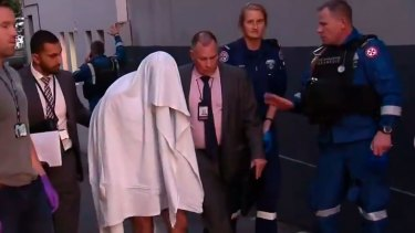 A man arrested at a home in Surry Hills remained in hospital with head injuries.