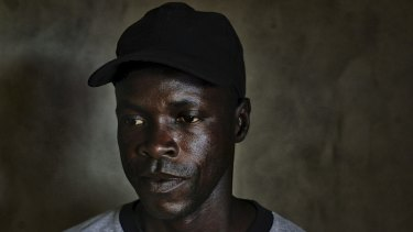 Alexander Kaine, who helped burn bodies during the Ebola outbreak, in Marshall, Liberia, last month.