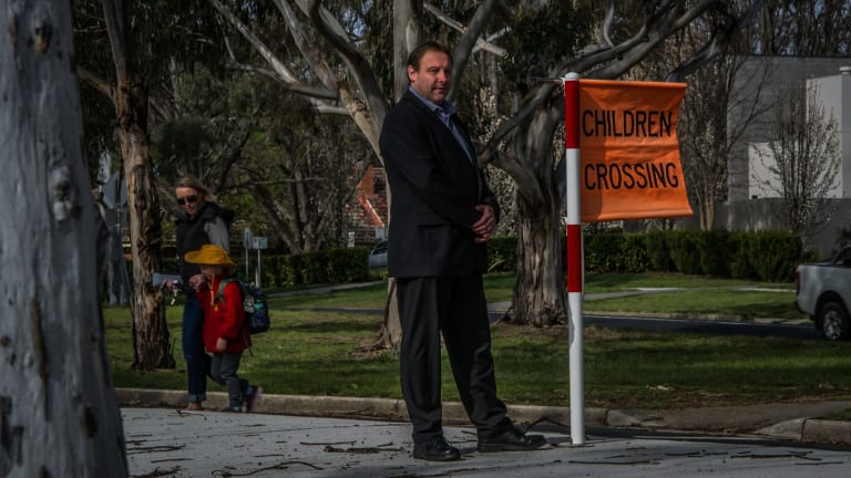 ACT council of Parents and Citizens Associations spokesman Adam Miller wants ACT election candidates to commit to addressing traffic chaos at school drop-off time.