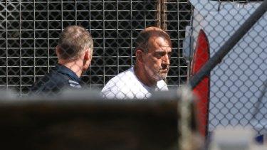 Michael Cardamone is taken into Wangaratta Court.