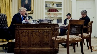 Donald Trump with national security adviser Michael Flynn and chief strategist Steve Bannon during a phone call with Australian Prime Minister Malcolm Turnbull.
