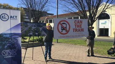 Members of Can the Tram make their views clear as they disrupt the government's light rail announcement.