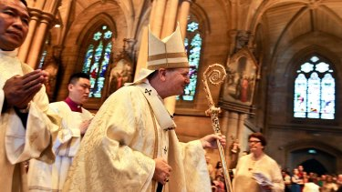 Sydney Archbishop Anthony Fisher leads the Christmas Day service at St Mary's Cathedral.