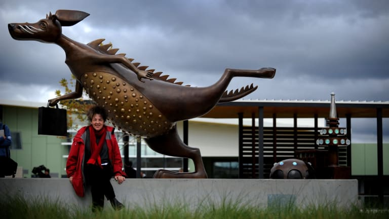 Artist Anne Ross with Gungahlin's sculpture<i>  A is for Alexander, B is for Bunyip and C is for Canberra</i>, which required $5370  of maintenance less than three years after it was unveiled.