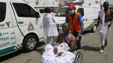 A rescue worker attends to a man injured in the stampede in Mina, Saudi Arabia.