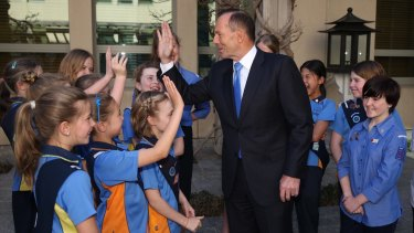 Prime Minister Tony Abbott with Girl Guides at Parliament House in Canberra on Monday September 14, 2015.
