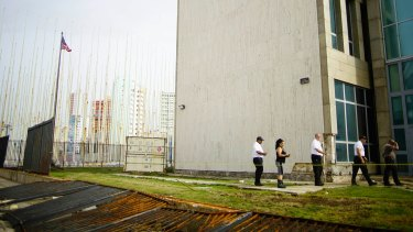 Personnel of the American Embassy in Havana inspect the damage caused by Hurricane Irma's powerful waves and storm surge to the embassy property.