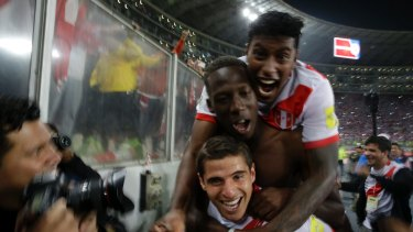 Peru's players celebrate after the final whistle.