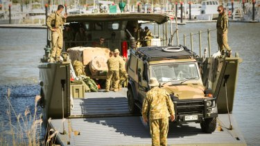 An Australian Army Mercedes Benz G-Wagon disembarks landing craft at the Keppel Bay Marina, Yeppoon, Central Queensland, bound for Rockhampton.