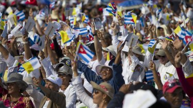 Thousands greet Pope Francis as he arrives to celebrate Mass at the Plaza of the Revolution in Holguin