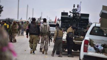 Members of Free Syrian Army advance towards al-Bab, Aleppo, on Thursday.