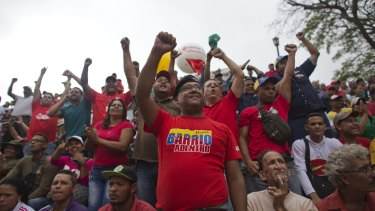 Supporters of President Nicolas Maduro marched to protest an amnesty law passed by the opposition-controlled congress calling for release of those it deems to be political detainees, on Thursday.