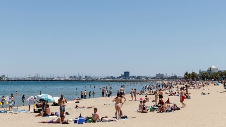 Crowds flock to St Kilda Beach on Christmas morning.