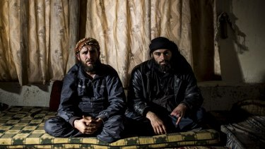 Hassan Aboud, left, with Abu Ayman in Sarmin, Syria, in 2013, when Aboud was leading attacks against Syrian army positions that were shelling the nearby civilian population nearby.